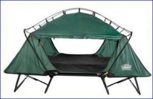 Double tent cot with open doors.