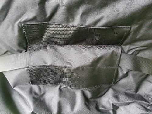 Three different positions for the lumbar strap for vertical adjustment.