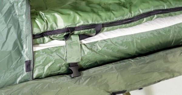 The pad's cover and the sleeping bags are attached to each other.