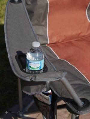 A bottle holder integrated in the armrest.